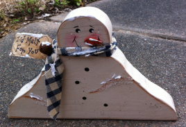 Primitive Wood Snowman  1672SNB Melting Snowman homespun scarf, rusty bell, and 'I'd melt for you' tag.